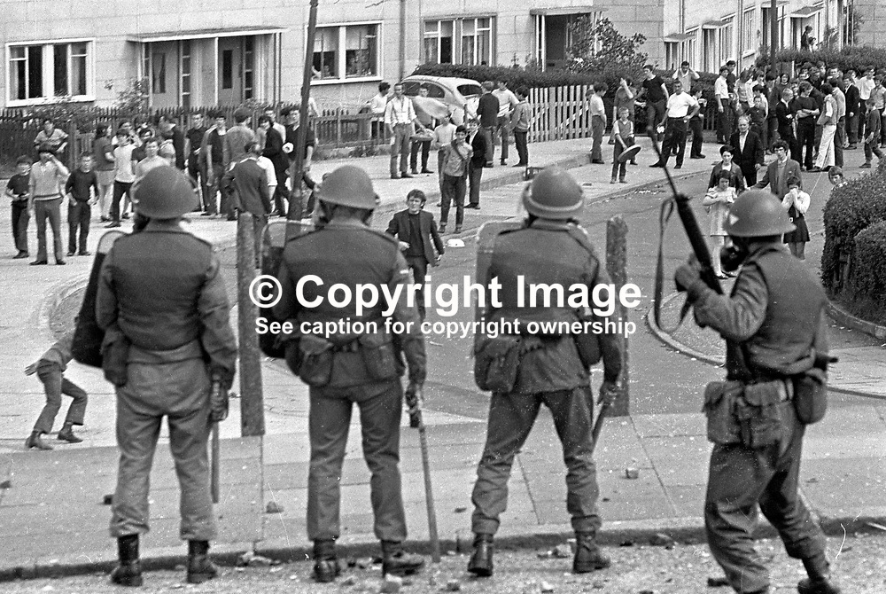 British soldiers confront rioters in Ballymurphy housing estate, West Belfast, N Ireland, UK. 197006270237. <br /> <br /> Copyright Image from Victor Patterson, Belfast, UK<br /> <br /> t: +44 28 9066 1296 (from Rep of Ireland 048 9066 1296)<br /> m: +44 7802 353836<br /> e: victorpattersonbelfast@gmail.com<br /> <br /> www.images4media.com<br /> <br /> Please see my full Terms and Conditions of Use at https://www.images4media.com/p/terms-conditions - it is IMPORTANT that you familiarise yourself with them.<br /> <br /> Images used online incur an additional cost. This cost should be agreed in writing in advance. Online images must be visibly watermarked i.e. © Victor Patterson or that of the named photographer within the body of the image. The original metadata must not be deleted from images used online.<br /> <br /> This image is only available for the use of the download recipient i.e. television station, newspaper, magazine, book publisher, etc, and must not be passed on to a third party. It is also downloaded on condition that each and every usage is notified within 7 days to victorpattersonbelfast@gmail.com.