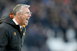 Hull City manager Nigel Adkins watches his team go close