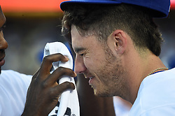 March 29, 2018 - Los Angeles, CA, U.S. - LOS ANGELES, CA - MARCH 29: Los Angeles Dodgers Right field Yasiel Puig (66) cleans the face of Los Angeles Dodgers First base Cody Bellinger (35) during the MLB opening day game between the San Francisco Giants and the Los Angeles Dodgers on March 29, 2018 at Dodger Stadium in Los Angeles, CA. (Photo by Chris Williams/Icon Sportswire) (Credit Image: © Chris Williams/Icon SMI via ZUMA Press)