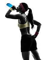 one woman exercising fitness drinking energy drink in silhouette on white background