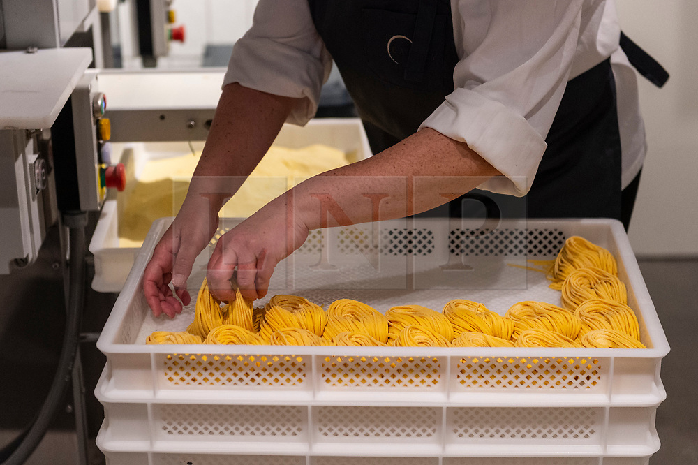 © Licensed to London News Pictures. 30/04/2021. LONDON, UK. A chef prepares fresh pasta as Eataly London opens in Bishopsgate.  The huge store is the first one to open in the UK and joins 42 others around the world in celebrating the cuisine of Italy with food counters, production labs, restaurants (open when lockdown restrictions allow) and an open market place for customers to participate in an innovative food and beverage experience.  Photo credit: Stephen Chung/LNP