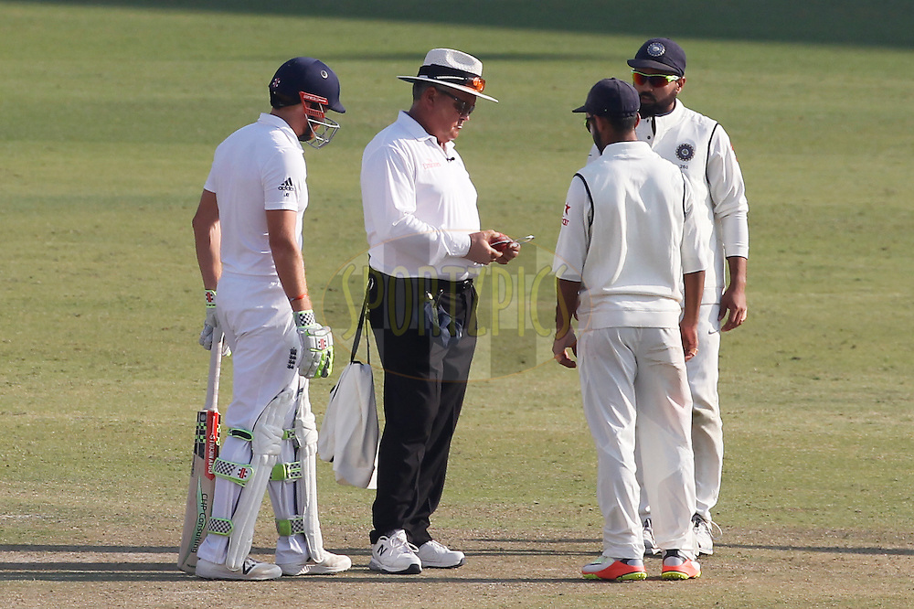 Ajinkya Rahane of India asks Umpire Marais Erasmus to check the ball for shape during day 1 of the third test match between India and England held at the Punjab Cricket Association IS Bindra Stadium, Mohali on the 26th November 2016.<br /> <br /> Photo by: Deepak Malik/ BCCI/ SPORTZPICS