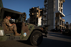 © Licensed to London News Pictures. 16/08/2020. Beirut, Lebanon. An army truck drives past a destroyed building in the Karantina district of Beirut which has been badly destroyed following the huge explosion in Beirut Port on 4 August. Photo credit : Tom Nicholson/LNP