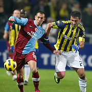 Fenerbahce's Selcuk SAHIN (R) and Trabzonspor's Umut BULUT (L) during their Turkish superleague soccer derby match Fenerbahce between Trabzonspor at the Sukru Saracaoglu stadium in Istanbul Turkey on Sunday 30 January 2011. Photo by TURKPIX