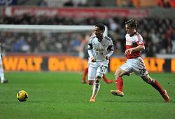 Fulham's Scott Parker plays the ball away from Swansea City's Jonathan de Guzman - Photo mandatory by-line: Alex James/JMP - Tel: Mobile: 07966 386802 28/01/2014 - SPORT - FOOTBALL - Liberty Stadium - Swansea - Swansea City v Fulham - Barclays Premier League