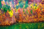 Colorful mountain lake at autumn