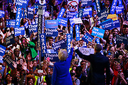 07272016 - Philadelphia, Pennsylvania, USA: Hillary Clinton joins President Barack Obama onstage after his speech in support of her during the third day of the Democratic National Convention. (Jeremy Hogan/Polaris)