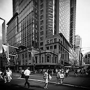 People crossing on street corners in Sydney, Australia