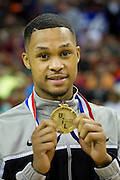 Jeremiah Jefferson (15) of Dallas Triple A Academy celebrates with his championship medal after defeating Mumford in the UIL 1A division 1 state championship game at the Frank Erwin Center in Austin on Saturday, March 9, 2013. (Cooper Neill/The Dallas Morning News)