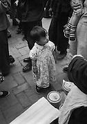 C012-7_Tom Hutchins_Small girl in crowd, at the market, Wang Fu Chin, Peking China A3.tif