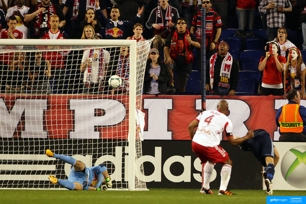 Aurélien Collin, Sporting Kansas City, scores the only goal of the match beating New York Red Bulls keeper Luis Robles at the near post during the New York Red Bulls V Sporting Kansas City, Major League Soccer regular season match at Red Bull Arena, Harrison, New Jersey. USA. 17th April 2013. Photo Tim Clayton