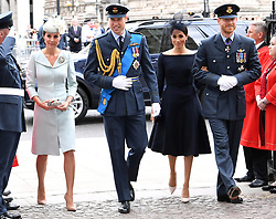 Catherine, Duchess of Cambridge (left), Prince William, Duke of Cambridge (second left), Meghan, Duchess of Sussex, and Prince Harry (right) during the RAF Centenary at Westminster Abbey, London. Photo credit should read: Doug Peters/EMPICS