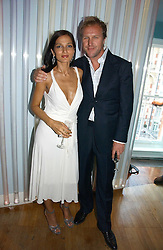YASMIN & SIMON MILLS at a party to celebrate the publication of 'How to Party' by Yasmin Mills with illustrations by Olympia Scarry, held at the Fifth Floor Restaurant, Harvey Nichols, Knightsbridge, London on 3rd July 2006.<br /><br />NON EXCLUSIVE - WORLD RIGHTS