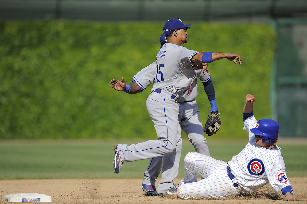 CHICAGO - MAY 30:  Rafael Furcal #15 of the Los Angeles Dodgers turns a double play over a sliding Ryan Theriot #2 of the Chicago Cubs during the game on May 30, 2009 at Wrigley Field in Chicago, Illinois.  The Cubs defeated the Dodgers 7-0.  (Photo by Ron Vesely)