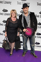 © Licensed to London News Pictures . 30/08/2017 . Salford , UK . Micky Dacks (r) . Purple carpet photos of celebrities, actors and invited guests arriving for the press night of the musical comedy , Addams Family , at the Lowry Theatre . Photo credit : Joel Goodman/LNP