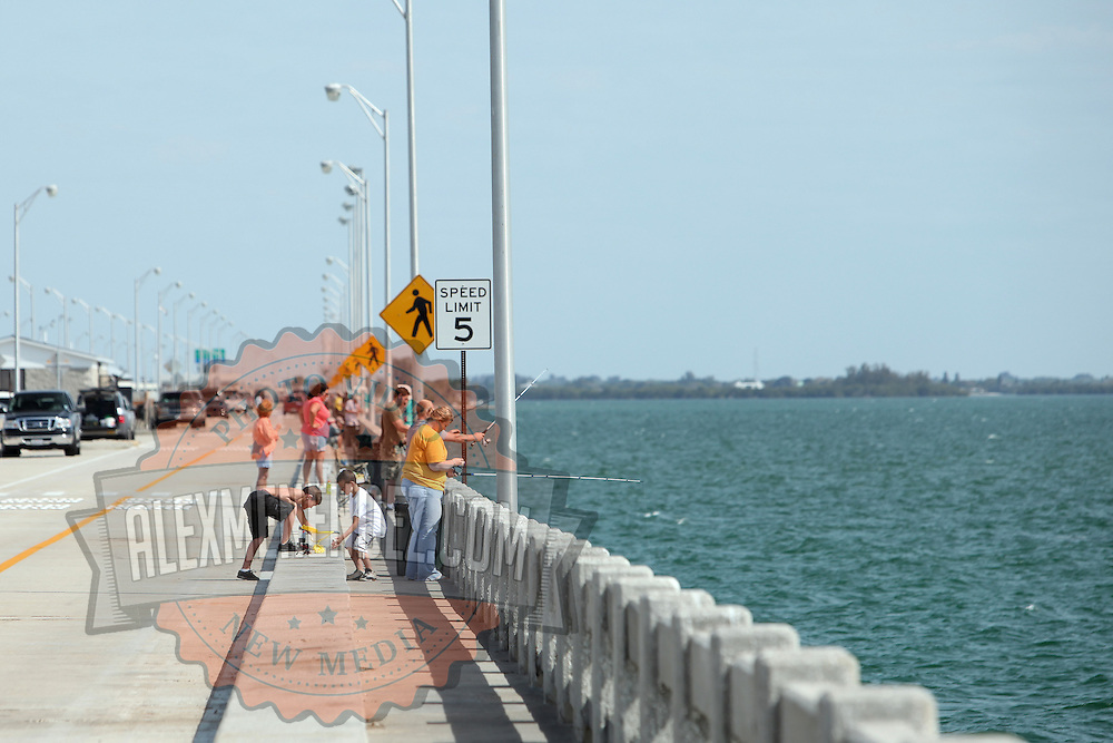 People fishing from a bridge in St. Petersburg, Florida. (AP Photo/Alex Menendez) Florida scenic highway photos from the State of Florida. Florida scenic images of the Sunshine State.