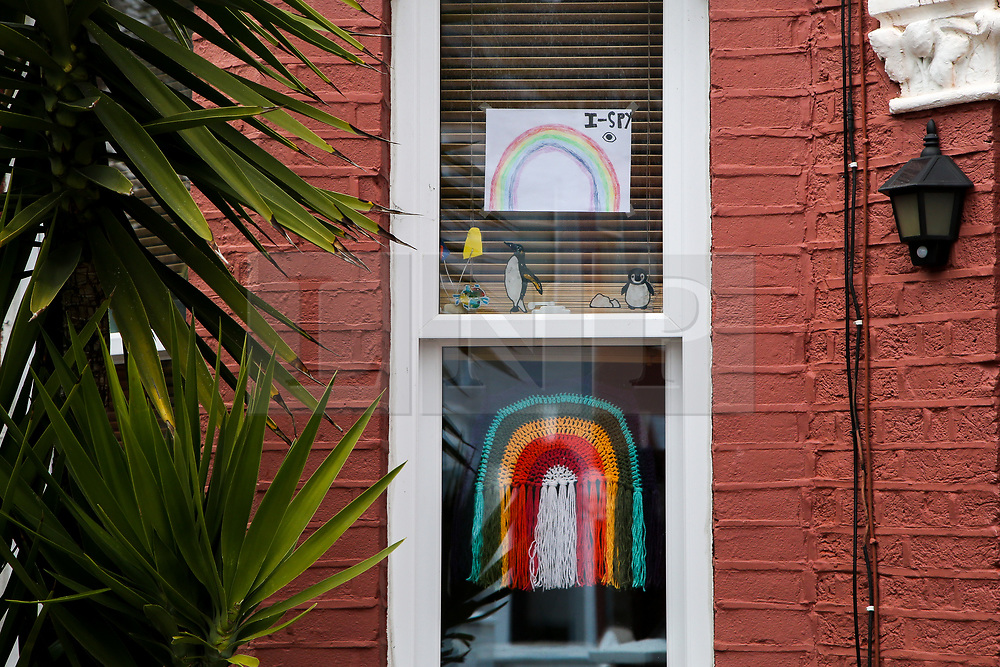 © Licensed to London News Pictures. 02/04/2020. London, UK. Hand painted rainbows on display in a window of a north London house. Rainbows are used as a symbol of peace and hope. Photo credit: Dinendra Haria/LNP