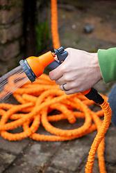 Stretch hose with hand spray attachment