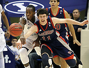 BYU forward Charles Abouo, left, and St. Mary's forward Clint Steindl, right battle for a loose ball on a rebound during the first half of an NCAA college basketball game in Provo, Utah, Saturday, Jan. 28, 2012. (AP Photo/Colin E Braley)