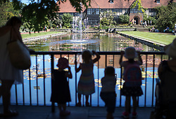 © Licensed to London News Pictures. 23/08/2016. Wisley, UK.  Small visitors to RHS Wisley stand in the shade as they look at the Canal. Photo credit: Peter Macdiarmid/LNP