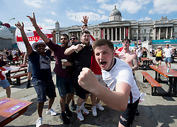 © Licensed to London News Pictures. 13/06/2021. London, UK. England fans celebrate at the final whistle. Fans gather in the Fan Zone at Trafalgar Square in central London for England's opening game of the 2020 European Championship against Croatia. Photo credit: Ben Cawthra/LNP