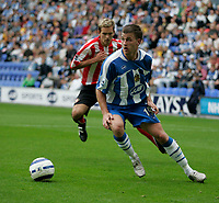 Photo: Peter Phillips.<br /> Wigan Athletic v Sunderland. The Barclays Premiership.<br /> 27/08/2005.<br /> Ryan Taylor turns to take the ball away from Martin Woods