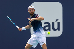 March 25, 2019 - Miami Gardens, FL, USA - Joao Sousa, of Portugal, returns a shot to Kevin Anderson, of South Africa, during their match at the Miami Open tennis tournament on Monday, March 25, 2019 at Hard Rock Stadium in Miami Gardens, Fla. (Credit Image: © Matias J. Ocner/Miami Herald/TNS via ZUMA Wire)