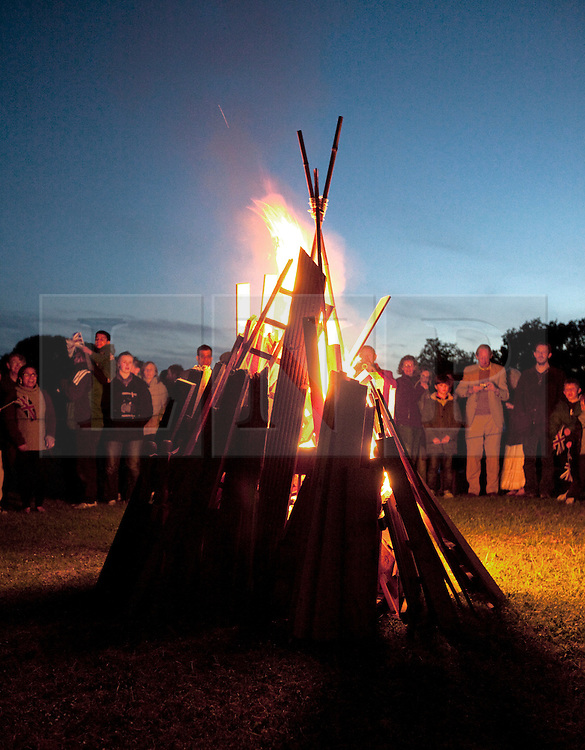 © Licensed to London News Pictures. 04/06/2012. London, UK. .A beacon is lit at Old Redding, Harrow Weald by the Pinner and Headstone Scouts..The Royal Jubilee celebrations. Great Britain is celebrating the 60th  anniversary of the countries Monarch HRH Queen Elizabeth II accession to the throne this weekend. Photo credit : Rich Bowen/LNP