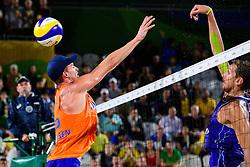 18-08-2016 BRA: Olympic Games day 13, Rio de Janeiro<br /> Brouwer/ Meeuwsen verslaan de Russen Viacheslav Krasilnikov en Konstantin Semenov in de kleine finale in twee sets met 23-21 en 22-20.<br /> <br /> Alexander Brouwer #1 en Robert Meeuwsen #2 zorgden zo voor de allereerste Nederlandse medaille bij het beachvolleybal op de Olympische Spelen. De sport staat sinds 1996 op de olympische agenda.