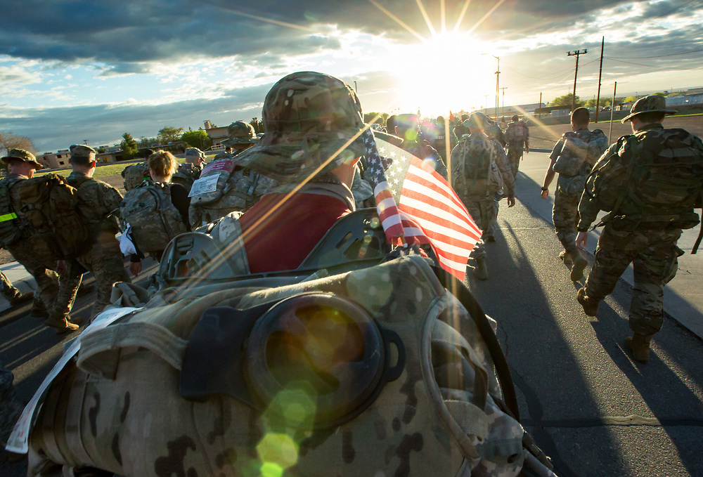 About 8,000 Participants march as the sun rises on Sunday March 25, 2018, during the Bataan Memorial Death March at White Sands Missile Range.