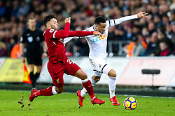 Alex Oxlade-Chamberlain of Liverpool is challenged by Martin Olsson of Swansea City - Rogan/JMP - 22/01/2018 - FOOTBALL - Liberty Stadium - Swansea, Wales - Swansea City v Liverpool - Premier League.