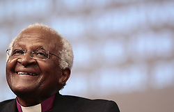 Archbishop Desmond Tutu speaks at Aid agency Tearfund's Who Is My Neighbour conference at Jesus House in Brent Cross, London.