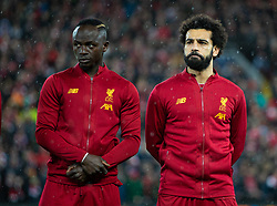 LIVERPOOL, ENGLAND - Wednesday, March 11, 2020: Liverpool's Sadio Mané (L) and Mohamed Salah line-up before the UEFA Champions League Round of 16 2nd Leg match between Liverpool FC and Club Atlético de Madrid at Anfield. (Pic by David Rawcliffe/Propaganda)