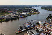 Nederland, Zuid-Holland, Ridderkerk, 23-05-2011; Noord en Nieuwe Maas werf Oord Dredging Kinderdijk IHC , schip Athena met dekkraan van baggeraar..Dockyard of dredger van Oord at the river Maas. .luchtfoto (toeslag), aerial photo (additional fee required).copyright foto/photo Siebe Swart