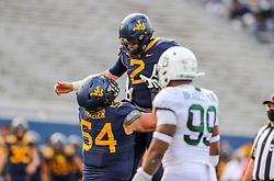 Oct 3, 2020; Morgantown, West Virginia, USA; West Virginia Mountaineers quarterback Jarret Doege (2) celebrates with offensive lineman Zach Frazier (54) after throwing a touchdown pass during the first overtime against the Baylor Bears at Mountaineer Field at Milan Puskar Stadium. Mandatory Credit: Ben Queen-USA TODAY Sports