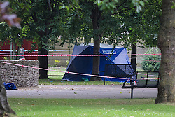 © Licensed to London News Pictures. 22/07/2016. LONDON, UK.  Police forensic tent inside West Ham Lane Recreational Ground, known as Stratford Park on West Ham Lane in Stratford, where a man in his 20's was stabbed and killed yesterday afternoon. Two men were arrested nearby on suspicion of murder and taken into custody at an east London police station. Photo credit: Vickie Flores/LNP