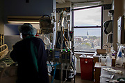 A view of the Little Village neighborhood out of an ICU window as respiratory therapist Bessy Piusten works with a COVID-19 patient on a ventilator Monday, May 11, 2020 at St. Anthony Hospital. (Brian Cassella/Chicago Tribune)