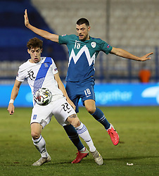 Kostas Tsimikas of Greece vs Haris Vuckic of Slovenia during football match between National teams of Greece and Slovenia in Final tournament of Group Stage of UEFA Nations League 2020, on November 18, 2020 in Georgios Kamaras Stadium, Athens, Greece. Photo by BIRNTACHAS DIMITRIS / INTIME SPORTS / SPORTIDA