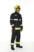 Studio photograph of a model against a white background wearing the fire service uniform of the London Fire Brigade