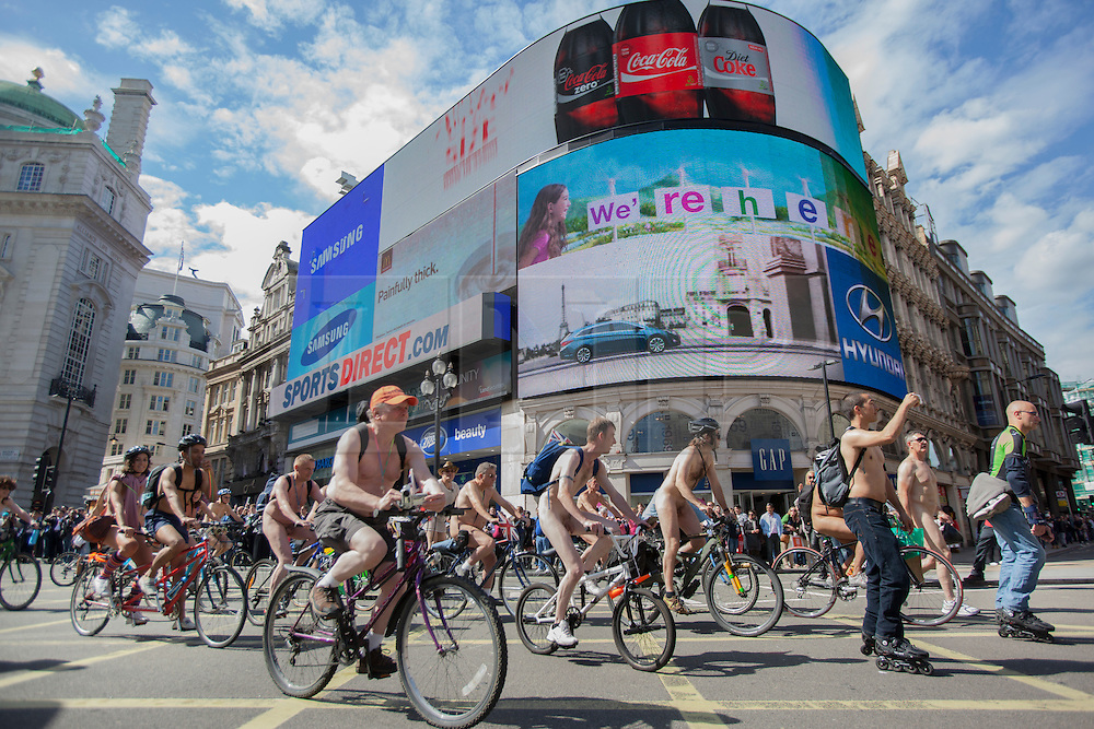 © licensed to London News Pictures. London, UK 09/06/2012. Cyclists having a naked bike ride in London to raise awareness of the need for more tolerance of bicycles on the road in the city. Photo credit: Tolga Akmen/LNP