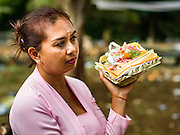 13 JULY 2016 - UBUD, BALI, INDONESIA:  A woman at the mass cremation in Ubud Wednesday. Local people in Ubud exhumed the remains of family members and burned their remains in a mass cremation ceremony Wednesday. Almost 100 people will be cremated and laid to rest in the largest mass cremation in Bali in years this week. Most of the people on Bali are Hindus. Traditional cremations in Bali are very expensive, so communities usually hold one mass cremation approximately every five years. The cremation in Ubud will conclude Saturday, with a large community ceremony.     PHOTO BY JACK KURTZ