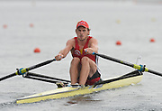 Trackai. LITHUANIA.  BEL BM1X, Hannes OBRENO waits in the rain for the start of his heat, Start, Heats. 2012 FISA U23 Rowing Championships, Lake Galve.   13:28:05 Thursday 12/07/2012 [Mandatory credit: Peter Spurrier/Intersport Images]..Rowing, U23, 2012.