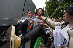© Licensed to London News Pictures . 20/06/2015 . London , UK . RUSSELL BRAND arrives at Parliament Square . Tens of thousands of people march from the Bank of England to Parliament , to protest economic austerity in Britain . Photo credit: Joel Goodman/LNP