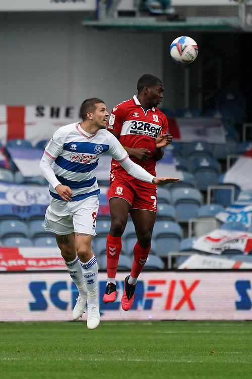 Middlesbrough's Marcus Tavernier battles for possession with Queens Park Rangers' Lyndon Dykes<br /> <br /> Photographer Stephanie Meek/CameraSport<br /> <br /> The EFL Sky Bet Championship - Queens Park Rangers v Middlesbrough - Saturday 26th September 2020 - Loftus Road - London <br /> <br /> World Copyright © 2020 CameraSport. All rights reserved. 43 Linden Ave. Countesthorpe. Leicester. England. LE8 5PG - Tel: +44 (0) 116 277 4147 - admin@camerasport.com - www.camerasport.com