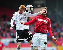Bristol City's Ryan Taylor wins the header against Charlton Athletic's Dorian Dervite - Photo mandatory by-line: Dougie Allward/JMP - Tel: Mobile: 07966 386802 04/05/2013 - SPORT - FOOTBALL - The Valley - London - Charlton Athletic V Bristol City - Npower Championship