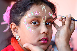 © Licensed to London News Pictures. 23/08/2019. LONDON, UK.  Gauri Khana (aged 8) has gopi dots facepaint applied as thousands celebrate the birth of Lord Krishna at the Janmashtami festival at the Bhaktivedanta Manor Hare Krishna Temple in Watford, Hertfordshire.  The manor was donated to the Hare Krishna movement by ex Beatle George Harrison and annually hosts the biggest Janmashtami festival outside of India. (Parental permission obtained).  Photo credit: Stephen Chung/LNP