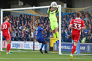Scunthorpe United goalkeeper Jak Alnwick (25) beating AFC Wimbledon striker Kweshi Appiah (9) to the ball during the EFL Sky Bet League 1 match between AFC Wimbledon and Scunthorpe United at the Cherry Red Records Stadium, Kingston, England on 15 September 2018.