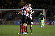 Lincoln City Defender Jamie McCombe (27) and Lincoln City Defender Luke Waterfall (5) celebrate victory at the final whistle during the The FA Cup fourth round match between Lincoln City and Brighton and Hove Albion at Sincil Bank, Lincoln, United Kingdom on 28 January 2017.