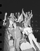 Republic Fans Celebrate Win.  (T8)..1989..11.10.1989..10.11.1989..11th October 1989..As part of the Italia 90 campaign,The Republic of Ireland took on Northern Ireland in a qualifier. A 3 nil win over Northern ireland virtually guaranteed the Republic a spot in the World Cup Finals..Rep. Ireland: Packie Bonner (Glasgow Celtic), Chris Morris (Glasgow Celtic), Mick McCarthy (Olympique Lyon) capt, Kevin Moran (Sporting Gijon), Steve Staunton (Liverpool), Ray Houghton (Liverpool), Ronnie Whelan (Liverpool), Andy Townsend (Norwich City), Kevin Sheedy (Everton), John Aldridge (Real Sociedad), Tony Cascarino (Millwall).Subs: David O'Leary (Arsenal) for Staunton 77 mins..N. Ireland: Dunlop, Fleming, McDonald, Donaghy, Worthington, D Wilson, McCreery, Whiteside, M O'Neill, Clarke, Dennison.Subs: C O'Neill for McCreery 71 mins, K Wilson for M O'Neill 79 mins.Goal scorers; Whelan,Cascarino,Houghton...Image shows the Anna Livia Statue in O'Connell Street ,Dublin adorned with celebrating Republic of Ireland fans.