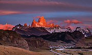 """Sunrise illuminates Cerro Fitz Roy (3405 meters or 11,171 feet elevation), as seen from Mirador al Chaltén on Ruta 23 just 2 km southeast of the village of El Chalten in Santa Cruz Province, Argentina, Patagonia, South America. Monte Fitz Roy is also known as Cerro Chaltén, Cerro Fitz Roy, or Mount Fitz Roy. The first Europeans recorded as seeing Mount Fitz Roy were the Spanish explorer Antonio de Viedma and his companions, who in 1783 reached the shores of Viedma Lake. In 1877, Argentine explorer Francisco Moreno saw the mountain and named it Fitz Roy in honour of Robert FitzRoy who, as captain of HMS Beagle, had travelled up the Santa Cruz River in 1834 and charted large parts of the Patagonian coast. Mt Fitz Roy was first climbed in 1952. Cerro is a Spanish word meaning hill, while Chaltén comes from a Tehuelche word meaning """"smoking mountain"""", due to clouds that usually form around the peak. This image was stitched from multiple overlapping photos."""